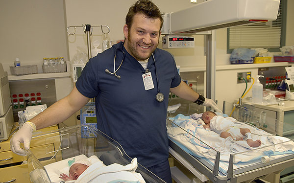 Nurse with neonates