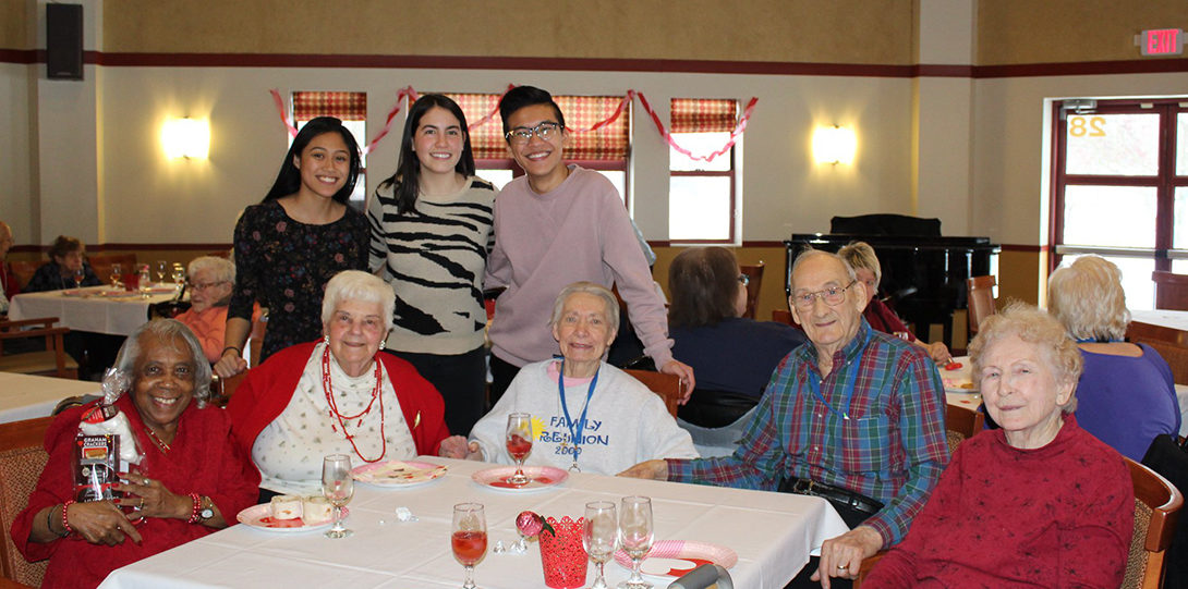 Students with residents in assisted living