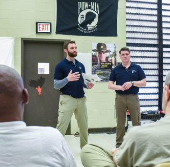 Chris O'Brien (left) and Jeremy Baker teaching male detainees