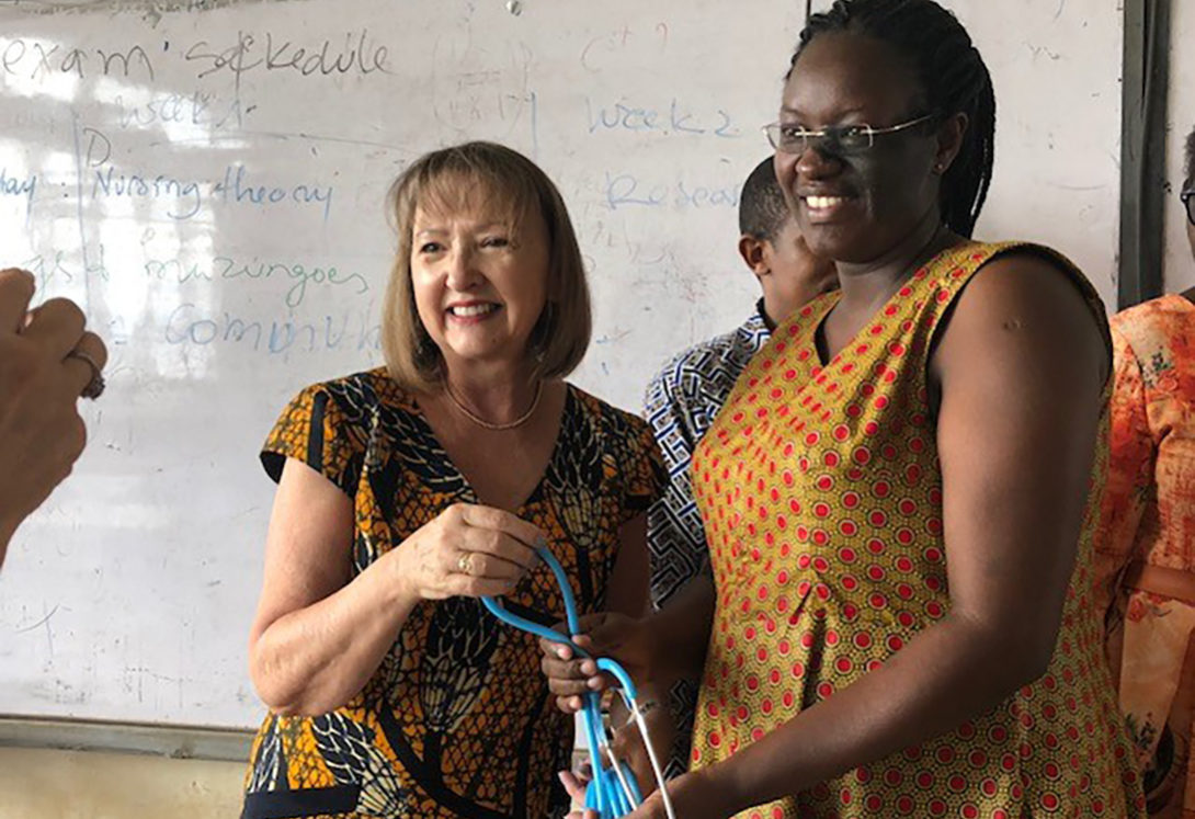 Holli DeVon delivering donated stethescopes to Rwandan nursing students