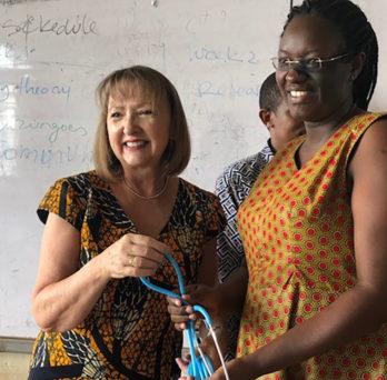 Holli DeVon delivering donated stethescopes to Rwandan nursing students