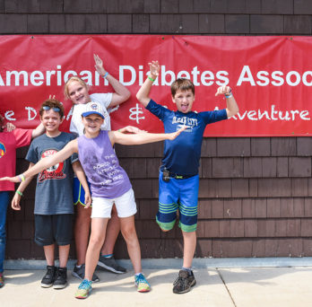 Laurie Quinn with kids at ADA camp