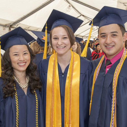 Three students at their graduation