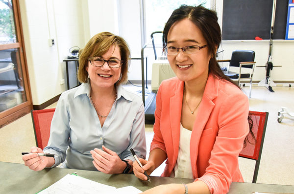 Student conducting research with UIC faculty member