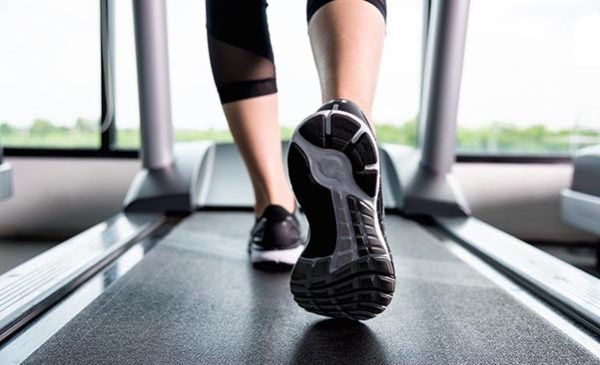 feet of person walking on treadmill
