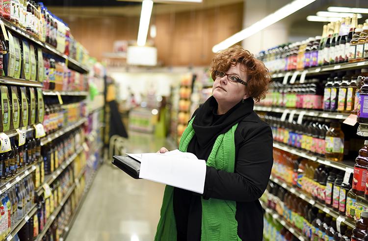 Shannon Zenk examining grocery offerings