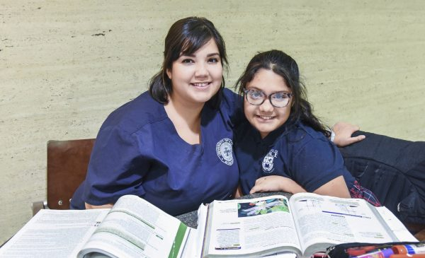 Student Jessica and daughter Abby study together