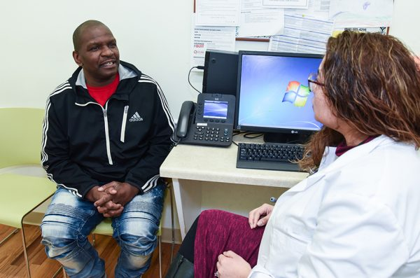 patient consults with nurse practitioner