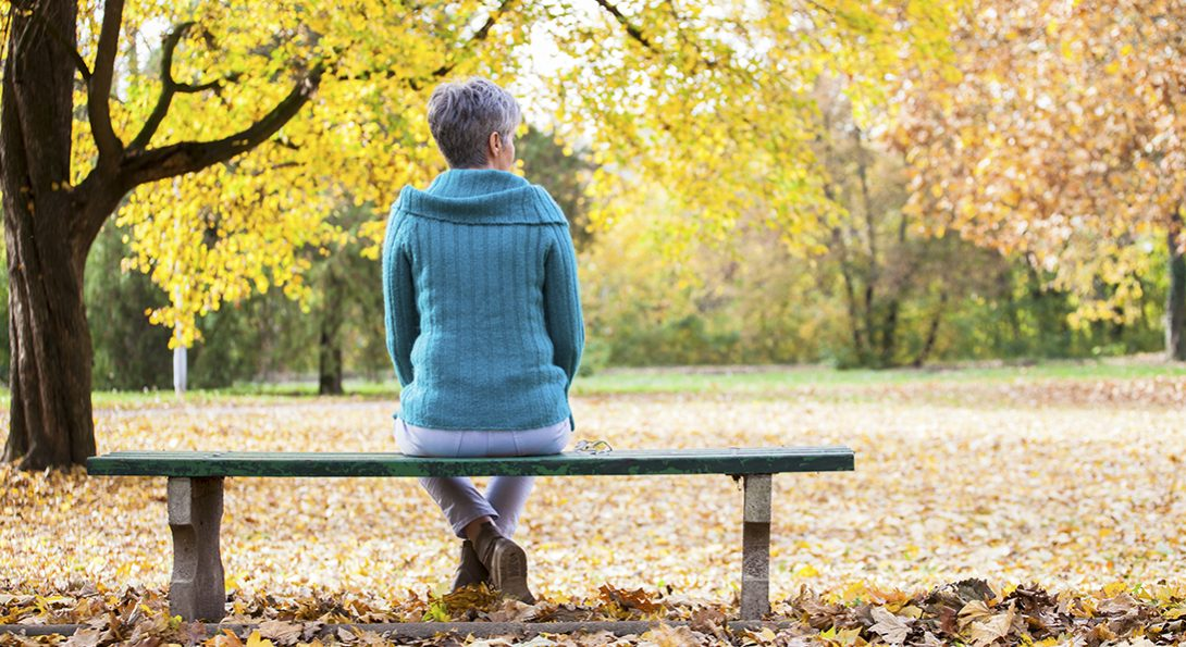Woman alone on park bench