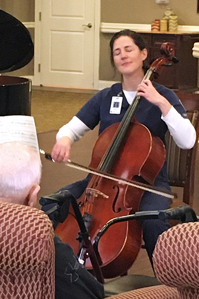 Kirsten Landowne plays cello for patients at the Carriage Crossing Senior Living facility