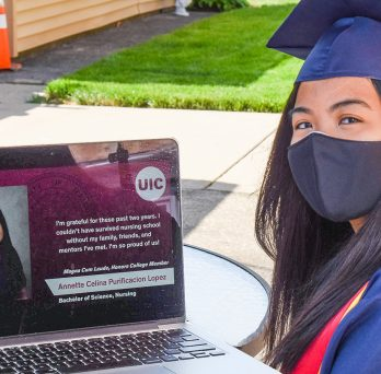 Student Annette Lopez watching her virtual graduation