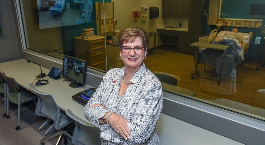 Terri Weaver posting in control room of simulated birthing suite