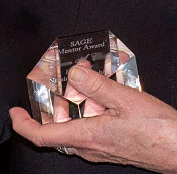 SAGE Award in hand