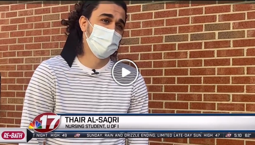 Urbana student Thair Al-Saqri being interviewed by WAND-TV news